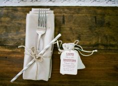 """Classic pocket fold with this """"champagne"""" poly napkin featuring a twine tie, stripped straw and cute favor at each place setting.   Nashville Garden Wedding and Reception Venue: CJ's Off the Square #weddingfavors"""