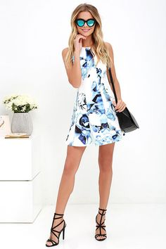 When it comes to cuteness, consider the Crystal Formation Ivory and Blue Floral Print Dress a natural wonder! Medium-weight woven fabric (with a bit of stretch) shapes a seamed sleeveless bodice with flared skirt. Modified racerback has a top button closure. Hidden back zipper.