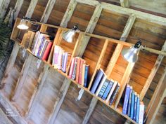 This shelf is made out of 1/2 of an old wooden ladder and then, lit with industrial lights.  Next time you see an old wood ladder, grab it!  Bachman's 2011 Summer Ideas House: Pt I  Bees Knees Bungalow