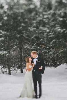 Snowy trees make picture-perfect wedding portrait backdrops | @benjhaisch | Brides.com
