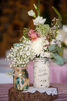 Amazing rustic country style wedding in a barn with vintage mason jar flower vases