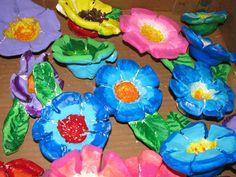 """3rd grade ceramic flower sculptures; approx. 4""""---5"""" wide; lesson by art teacher: Susan Joe"""