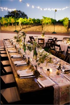 candle lit reception with strands of lights over tables #weddingreception #weddinglighting #weddingchicks http://www.weddingchicks.com/2014/03/17/shabby-chic-winery-wedding/