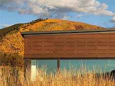 The Starwood residence sits on a ridge line overlooking the Roaring Fork Valley and views to the Elk Mountains beyond.