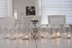 Mason jar candles with tealight candles! What a beautiful, simple centerpiece!