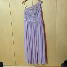 SOLD My David's Bridal Lavender one Shoulder Gown Size 18 floor length by David's Bridal! Size 18 / 1X for $$50.00. Check it out: http://www.vinted.com/womens-clothing/formal-dresses/22223973-davids-bridal-lavender-one-shoulder-gown-size-18-floor-length.