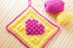 Fun pot holder to make, pick bright colors to lighten your day! You'll need: H and I crochet hooks cotton yarn (like Sugar'n Cream; Hot Pink and Sunshine) Scissors Tapestry Needle Click HERE for th...