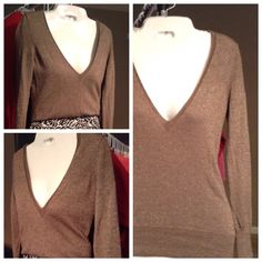 "The Limited Sweater Beautiful brown Sweater by THE LIMITED.  It's made of 85% Wool 10% Metallic and 5% Nylon.  Comfortable and stylish. Size XS. The Length is ""24.  Arm to Arm laying Flat is ""14. This sweater stretches.  In Good condition with normal wear. Offers through the offer button ONLY. Non Smoking home The Limited Sweaters"