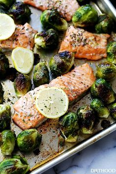 One Sheet Pan Garlic Roasted Salmon with Brussels Sprouts | Incredibly delicious, garlicky, super flavorful one-pan dinner with oven-roasted salmon and brussels sprouts.