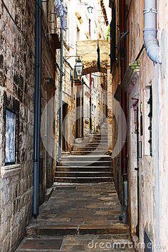 Old Stairs On Narrow Pathway Stone Buildings Stock Photo - Image of city, light: 92246198 Pathway Stone, Dubrovnik Croatia, Pathways, Buildings, Stairs, Stock Photos, Dark, City, Image