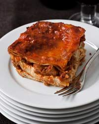 Grandmas Lasagna CONTRIBUTED BY GRACE PARISI Although we tested three different Bolognese-style lasagnas with creamy béchamel sauce, we decided that the definitive lasagna had to have tomato sauce, chunks of meat, shredded mozzarella and creamy ricotta cheese. WNBooks.com