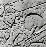 "chap5-10-2-23.jpg Close-up of one of the reliefs from Pharaoh Ramses III.'s Tomb at Medinet Habu on the Nile's west bank. His reign 1183-1152 BC This is a warrior from the ""water people"". His helmet is behornet and his arms are around. Compare his bronze sword with the above showed from the Danish countryside"