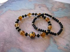 Carved  golden dragon  black onyx & mantra by Shynnasplace on Etsy, $35.00