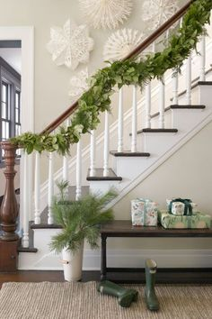 In this Connecticut farmhouse, the owners opted for an intricate FiftyFlowers garland that incorporates fresh asparagus ferns and evergreen shrubs.