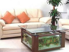 If you think that aquarium is home for fish, you are half right. Modern aquarium is creative. Aquarium table do two functions: coffee table and home for fish Fish Tank Table, Fish Tank Coffee Table, Hexagon Coffee Table, Coffee Table Design, Coffee Tables, Aquarium Design, Conception Aquarium, Interior Design Tips, Interior Decorating