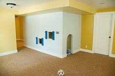 I am so mad now that we built a closet under our stairs instead of this in the playroom. How awesome??!!