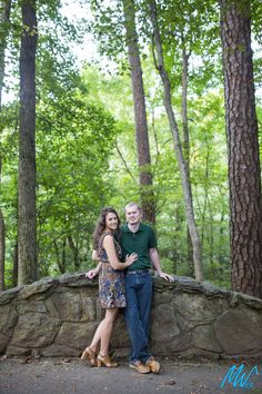 Your outfits should reflect the season and what colors look the best on you! The forest green shirt on the groom-to-be work perfectly with the surrounding trees and the bits of green in the bride-to-be's dress