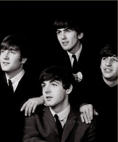 The Beatles while still young. Not too flattering a shot of Paul.