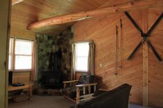 Little Pond Lodge Vacation Rentals: The Log Cabin Living room has vaulted ceiling and cast iron gas fireplace.