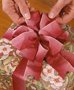 DIY Festive Bows ~ What You Need: ■1 block floral foam or Styrofoam, approximately 10 in. long, 3 in. wide, & at least 2 in. deep   ■Two 6-inch lengths of 1/4-in. dowel (other diameters can also be used)   ■Ribbon as desired   ■Scissors