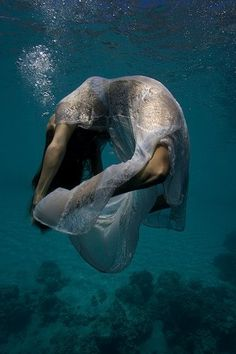 Water yoga. Loved and Pinned by www.downdogboutique.com to our Yoga community boards