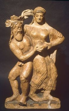 SATYR AND MAENAD / FROM SATRICUM. Etruscan, late Archaic, c. 490 BC. Antefix with Satyr and Maenad. Terracotta, height c. 59cm. From: Temple of Mater Matuta in Satricum (Conca, Latium). Inv. No. 10259