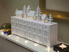 White Village Scene Advent Calendar, with a lift up lid, you may even find a treat behind the door (gifts/treats) countdown the days to Christmas. All Things Christmas, Winter Christmas, Christmas Holidays, Christmas Decorations, Christmas Ornaments, Christmas Lights, Christmas Tables, Nordic Christmas, Modern Christmas