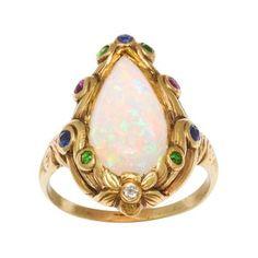 Opal, Sapphire, Garnet, & Diamond Ring in 18K Gold. Retailed by J.E. Caldwell. Matches circa 1920s design in Gustav Manz archive