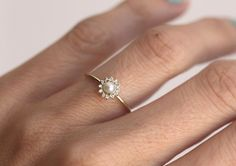 Such a dainty pearl engagement/wedding ring!