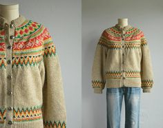 This vintage Norwegian wool fair isle cardigan will keep you warm and toasty through all the chilly days ahead. Beautifully hand knit rounded yoke