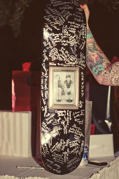 Rockabilly Wedding: sign a skateboard. Lot's of other really cute alt wedding pics!
