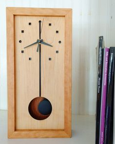 Squares & Circles Box Clock! Handcrafted in Asheville from certified sustainable Appalachian cherry and hard maple woods, with a fine, hand-rubbed oil finish. Modern design. May be hung on the wall or placed on a shelf. Craftsman Wall Clocks, Wall Clock Design, Clock Wall, Pendulum Clock, Cool Clocks, Modern Clock, Scroll Saw Patterns, Wooden Watch, Wood Design