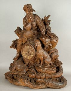 exceptional carved wood mantel clock by the famous woodcarver johann huggler swiss brienz, ca. 1870.