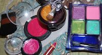 take empty make up containers and fill ith dif color nail polishes. let dry and now you have your own play make up for your daughter. (follow the link for tons of fun cheap/free ideas to do with your kids!)