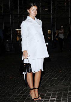 Miroslava Duma dresses her baby bump in a white double-breasted coat + white silky dress + black single-sole heels