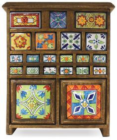 vintage curio cabinet with painted ceramic drawers                                                                                                                                                                                 More