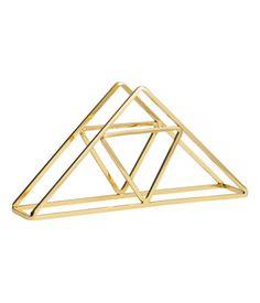Guld. Ett servettställ i guldfärgad metall. Storlek 3,5x8x16 cm.