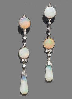 A pair of opal and diamond pendent earrings  Each opal drop suspended from a chain of old brilliant-cut diamonds and circular cabochon opals in closed-back settings, length 6.2cm.