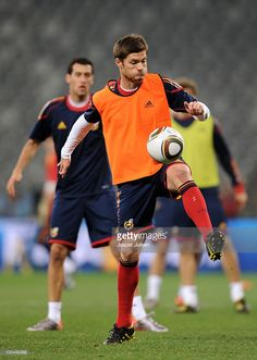 Xabi Alonso of Spain controls a ball during a training session, ahead of their 2010 World Cup Stage 2 Round of 16 match against Portugal, at the Green Point Stadium on June 28, 2010 in Cape Town, South Africa.