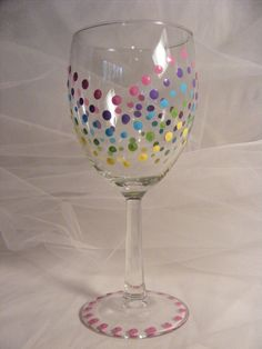 painted birthday wine glass with a rainbow of multi-colored polka dots - ready to be personalized. $15.00, via Etsy.