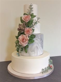 Grey marble, pink sugarpaste roses, eucalyptus and succulent.