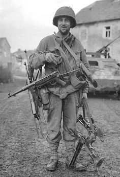 US army GI with some interesting German weaponry souvenirs, France 1944