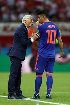 Jose Pekerman Head coach of Colombia speaks to James Rodriguez of Colombia during the 2018 FIFA World Cup Russia group H match between Poland and...