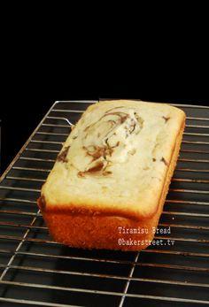 Tiramisu Bread frosting recipe here: http://bakerstreet.tv/2012/07/kahlua-mascarpone-frosting/