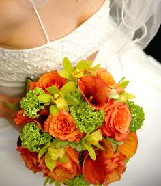 Wedding Bridal Bouquet, tomobi, Bridal floral arrangement designed with burnt orange rose, vivurnum, mini green cymbidium, & orange calla lilly.