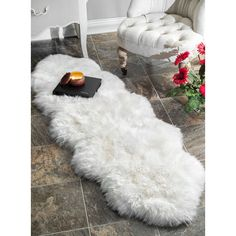 Soft, plush and fashion-forward is the perfect way to describe this sheepskin rug. Made of real sheepskin hide, you won't want to let go of this fabulous rug. This shag rug is a great accent piece for any room or can be used as a throw on a bed or couch.
