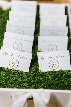 Wedding escort cards in a grass lined drawer | Elias Kordelakos Photography | Bridal Musings Wedding Blog