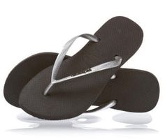 272f8c277eaaf Havaianas Black and Silver Metallic Flip Flops. The Havaianas Logo Metallic  Silver sandal was created to accent your summer wardrobe.