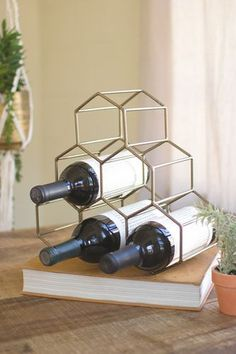 """Wire Geometric Wine Bottle Holder -Antique Brass Dimensions (in):12"""""""" x 5"""""""" x 11.5""""""""t By Kalalou - Kalalou is a wholesale manufacturer of distinctive home & garden decorative accessories. Usually ship"""
