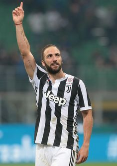 Gonzalo Higuain of Juventus FC celebrates the victory at the end of the serie A match between FC Internazionale and Juventus at Stadio Giuseppe Meazza on April 28, 2018 in Milan, Italy.